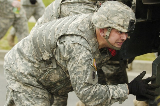 Sgt. 1st Class Gerald Sprague of the 593rd Sustainment Brigade leans into an MTV.