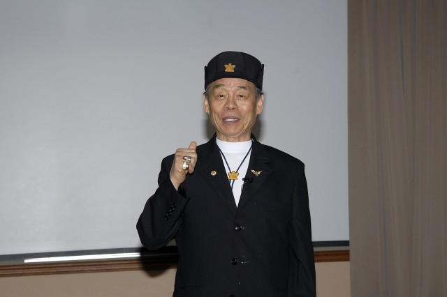 Grand Master Jhoon Rhee addresses a group of more than 200 Soldiers and civilians during the SMDC/ARSTRAT Asian Pacific American Heritage Month Observation at Operational Headquarters, Building 3, Peterson Air Force Base, Colo., on May 8. World-renowned 10th Degree Black Belt, Rhee is known as the Father of American Tae Kwon Do.
