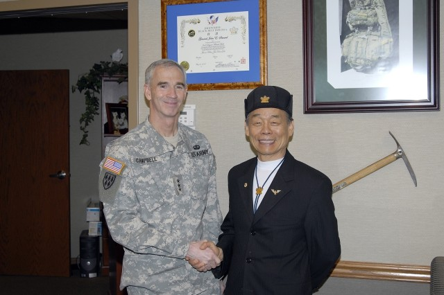 Lt. Gen. Kevin T. Campbell, commanding general, SMDC/ARSTRAT, poses with Grand Master Jhoon Rhee at Operational Headquarters, Peterson Air Force Base, Colo. Rhee was the invited speaker for the 2008 SMDC/ARSTRAT Asian Pacific American Heritage Month Observation in Building 3.