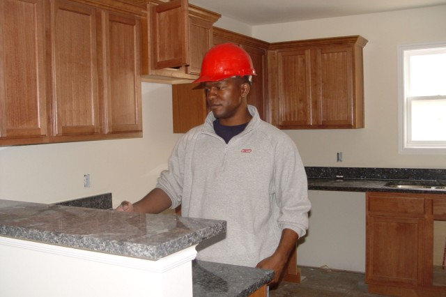Capt. Derrick Miller works at a home development site in Junction City, Kan. Miller is one of several Soldiers in the Fort Riley, Kan., Warrior Transition Battalion who are taking advantage of the Warrior Internship Network -- a new program that offers internships to Soldiers in the WTB.