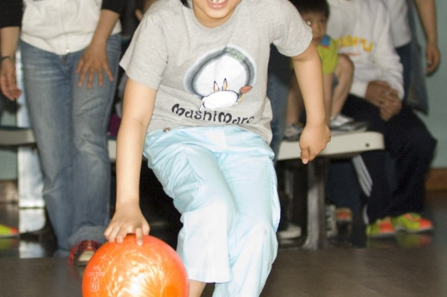 YONGSAN GARRISON, Republic of Korea - Nine-year-old Kim Yun-bin bowls at Yongsan Lanes during a Children's Day Good Neighbor activity May 4. Korean families and their children joined U.S. Soldiers assigned to Yongsan to celebrate Korean