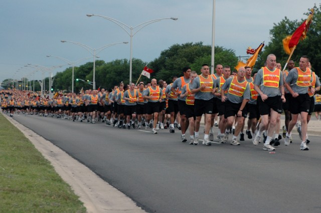 At the head of the pack, Maj. Gen. Daniel P. Bolger (left), commanding general of the 1st Cavalry Division, runs beside Col. Gary Volesky, commander of the 3rd Brigade Combat Team on Fort Hood, Texas, during a brigade run, May 12.