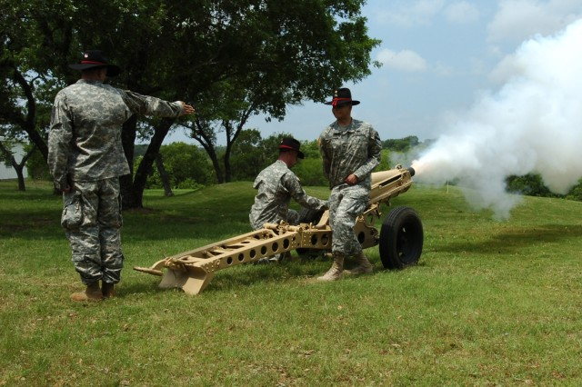Soldiers from the 3rd Battalion, 82nd Field Artillery, 2nd Brigade Combat Team, 1st Cavalry Division, fire a cannon signifying the start of the Black Jack Golf Scramble at Clear Creek Golf Course on Fort Hood May 7.
