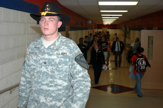 """Cleveland, Ohio, native Sgt. Sean Schwartfigure, a mechanic for 615th Aviation Support """"Cold Steel"""" Battalion, 1st Air Cavalry Brigade, 1st Cavalry Division, walks down a hall of Midway High School in Waco, Texas, during a visit May 9. Cold  Steel visited the Midway Panthers to thank them for the care packages they sent to them while they were deployed to Iraq."""
