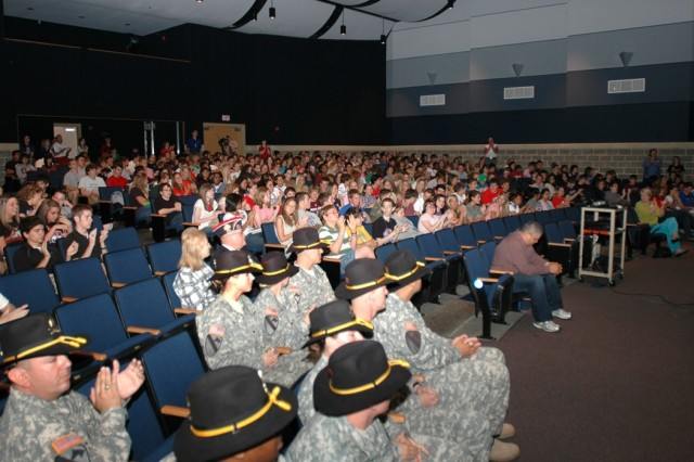 """Soldiers from 615th Aviation Support """"Cold Steel"""" Battalion, 1st Air Cavalry Brigade, 1st Cavalry Division, get ready to take the stage for students and faculty at Midway High School in Waco, Texas, during a ceremony May 9. The Midway Panthers sent hundreds of goodie boxes to Cold Steel while they were deployed to Iraq. The student learned about the cavalry and the meaning behind wearing the gold combat spurs."""