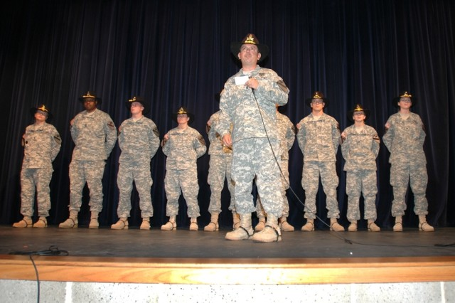 """Dallas, Texas, native Command Sgt. Maj. Glen Vela, the senior noncommissioned officer for 615th Aviation Support """"Cold Steel"""" Battalion, 1st Air Cavalry Brigade, 1st Cavalry Division, thanks the faculty and students of Midway High School in Waco, Texas, during a ceremony at the school May 9. The Midway Panthers sent hundreds of goodie boxes to Cold Steel while they were deployed to Iraq."""