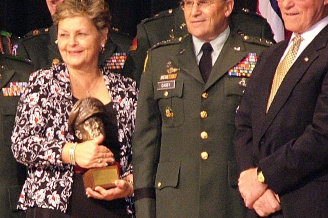Mrs. Mary Kennedy, Gen. George W. Casey, Jr., and Mr. David Thiel of the Gen. Douglas MacArthur Foundation pose for a group picture at the awards ceremony. Kennedy accepted the award on behalf of her son, Capt. Edward E. Kennedy of Army Forces Command, who is currently deployed.