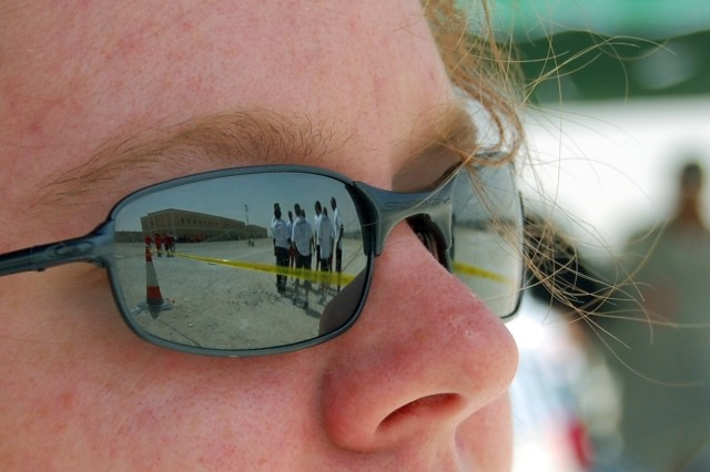 "Sgt. Kimberly Vock, 1st Battalion, 401st Army Field Support Brigade looks out at members of the battalion as they get ready to compete in the Kickball event of the Camp As Sayliyah, Qatar Commander's Cup, Apr. 19, 2008. Representing the ""Champion Brigade"" and Army Material Command, the battalion's team fought hard, but wound up on the short end of a 1-0 battle against Area Support Group - Qatar."