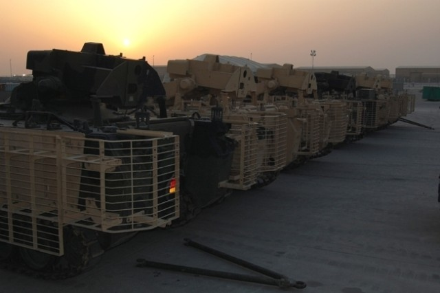 "Fire Support Team Vehicles are staged on the ready line in the 2nd Battalion, 401st Army Field Support Brigade area at Camp Arifjan, Kuwait, April 27. The vehicles are destined for employment in Operation Iraqi Freedom and were ""up-armored"" by 2nd Battalion."
