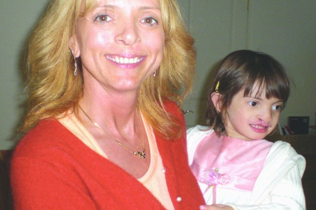 Karen Sellers-Myers holds her adopted daughter Sophia after surgery that began repairs to Sophia's cleft palate.