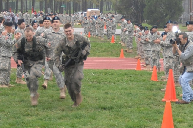 Capt. Jason Winkelmann, left, and 2nd. Lt. Joel Groves, right, both from the 8th Battalion, 36th Engineer Brigade, Fort Hood, Texas, run to cross the finish line in the last event of the 2008 Best Sapper Competition at Fort Leonard Wood, Mo., May 6-8. Winkelmann and Groves won first place and the title of Best Sappers.
