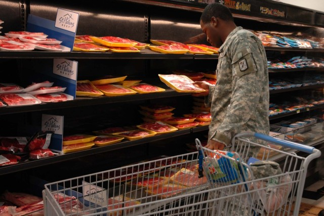 Sgt. Roddrick Johnson of 125th Finance Battalion, 25th Infantry Division, inspects the selection of meat products at the Schofield Barracks commissary. Johnson shops at the post commissary for the sake of convenience and savings.