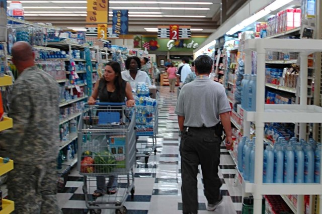 Shoppers line the aisles of the Schofield Barracks commissary for groceries and household goods. The commissary provides the military ohana with an array of products available at cost plus a 5-percent surcharge.