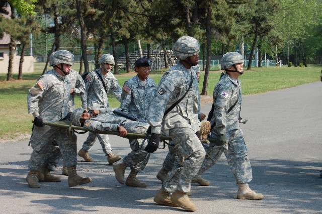 176th Finance Company Soldiers practice a medical evacuation May 15 at Camp Market.