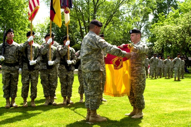 Col. Joseph Fischetti, commander of the 69th Air Defense Artillery Brigade (right), and Sgt. Maj. David Gonzales, the brigade's acting command sergeant major, prepare the units colors for casing during a ceremony on Leighton Barracks in Würzburg, Germany, May 13.
