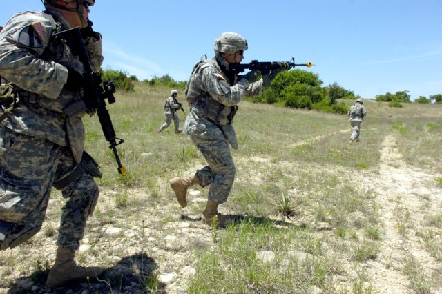Soldiers from Troop B, 4th Squadron, 9th Cavalry Regiment, 2nd Brigade Combat Team, 1st Cavalry Division, rush a simulated enemy hideout during a situational training exercise May 8.