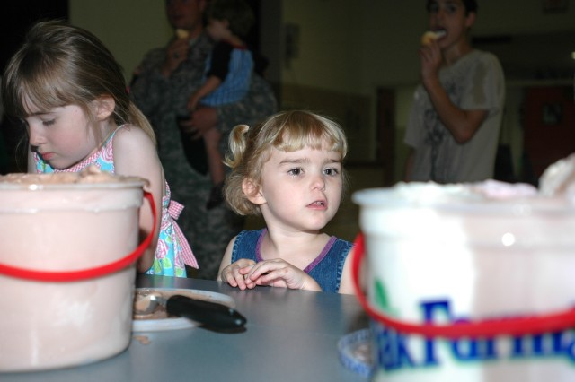 Raychel Fortner (center), 4, and her sister, Saara, 5 (left), look over their options during an ice cream social sponsored by Headquarters and Headquarters Company, 1st Air Cavalry Brigade, 1st Cavalry Division, Family Readiness Group, May 14. The informal meeting was held so that families could acquaint themselves with each other well in advance of the next training and deployment dates, said Plano, Texas, native Capt. Tracey Lewis, commander of HHC, 1st ACB, 1st Cav. Div.