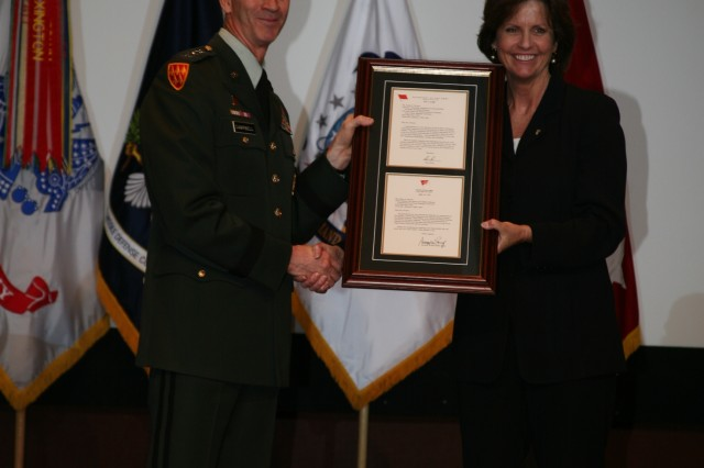 LTG Kevin T. Campbell, commanding general, SMDC/ARSTRAT, congratulates Debra Wymer on her selection to the Senior Executive Service on May 16 at her promotion ceremony at Bob Jones Auditorium at Redstone Arsenal, Ala.