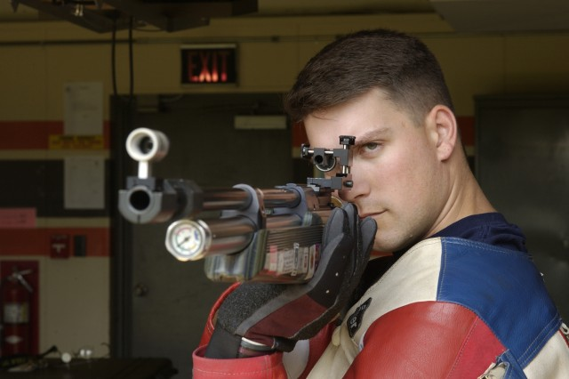 Sgt. 1st Class Jason Parker of the U.S. Army Marksmanship Unit prepares to fire. He continues to hold first place in Men's Three-Position Rifle event with a total score of 2546.6.