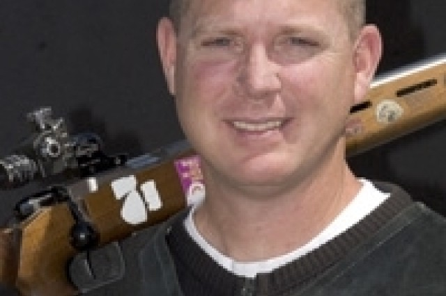 """Maj. Mike Anti of the U.S. Army Marksmanship Unit poses with his rifle. He qualified for a spot on the 2008 U.S. Olympic team at the 2008 U.S. Olympic Team Trials - Shooting (Smallbore)."""""""
