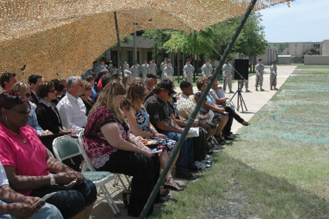 Soldiers and family members gather in front of the 2nd Battalion, 8th Cavalry Regiment memorial at Fort Hood, Texas May 16 during a memorial dedication ceremony honoring Stallion troopers who died during Operation Iraqi Freedom 06-08.