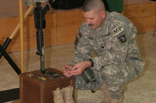 Army Lt. Col. Daryl Johnson, commanding officer, 504th Military Police Battalion., which is attached to Regimental Combat Team 5, remembers Army Pfc. Aaron Ward during a memorial service at the chapel on Al Asad Air Base, Iraq, Friday. Ward, 19, a military policeman with 170th Military Police Company, 504th MP Bn., was killed, May 6, while on a combat patrol in western Anbar province, Iraq. Pfc. Ward, who was from Temecula, Calif., had only been in Iraq since March.