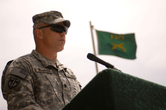 Lt. Col. Michael Blahovec, commander of the 793rd Military Police Battalion, makes his remarks during the ceremony in which the battalion accepted its deployed mission in Iraq, at Camp Stryker May 14.