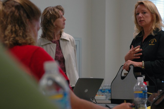 Bennington, Vt. native Lori Carpenter (right), the 3rd Brigade Combat Team, 1st Cavalry Division, Family Readiness Support Assistant, shares experiences with a group of go team and care team volunteers at the Oveta Culp Hobby Soldier and Family Readiness Center, on Fort Hood, Texas, May 14