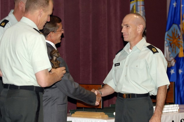 FORT BLISS, Texas (May 19, 2008) -- Master Sgt. David A. Galati (right) shakes the hand of guest speaker Retired Brig. Gen. Jose D. Riojas (center) at the U.S. Army Sergeants Major Academy baccalaureate ceremony May 19. After honoring Galati for earning his collegiate degree, academy commandant Col. Donald Gentry (left), awarded Galati as the Sergeants Major Course Class 58 Iron Soldier -- for the highest score on the Army physical fitness test -- and for military excellence in leadership. The two awards are usually presented at the academy graduation on May 22 but was presented to Galati at the baccalaureate because he had to leave for his next assignment shortly after the ceremony. (Photo by Master Sgt. Eric Pilgrim)