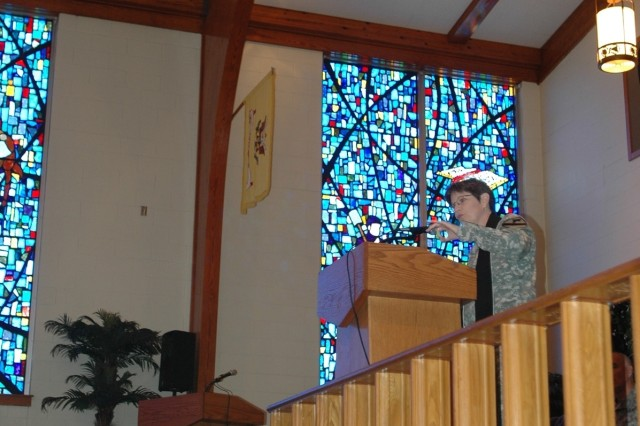 "Chaplain (Lt. Col.) Barbara Sherer, incoming 1st Cavalry Division chaplain, speaks during a changing of the stole ceremony at the1st Cav. Div. memorial chapel May 20. Sherer is an ordained Presbyterian minister who has published numerous articles and is a co-author of a thriller series the ""Eden Thrillers."""