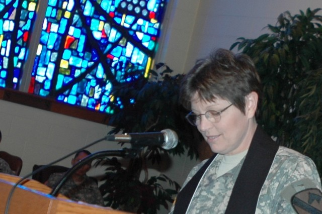 Springfield, Mo. native Chaplain (Lt. Col.) Barbara Sherer, incoming 1st Cavalry Division chaplain, speaks during a changing of the stole ceremony at the1st Cavalry Division's memorial chapel May 20. During her speech, Sherer extended her gratitude to the outgoing Chaplain (Lt. Col.) Steve Walsh and his wife Lisa for all their assistance during this transition.