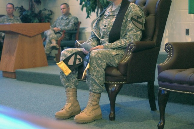 Springfield, Mo. native Chaplain (Lt. Col.) Barbara Sherer, incoming 1st Cavalry Division chaplain, waits to speak after the 1st Cavalry Division's commanding general Maj. Gen. Daniel P. Bolger passed her the stole and its responsibilities, during a changing of the stole ceremony at the division's memorial chapel May 20. Historically, the stole was the visible symbol of the authority and responsibility held by government officials.