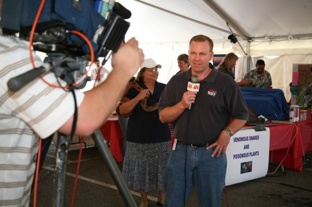 WAFF Channel 48's Chief Meteorologist Brad Travis reports live from the Joint Safety Awareness Day tent for the noon news broadcast on May 20.