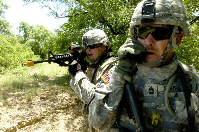 "Sgt. 1st Class Chris Souba communicates with troops in helicopters overhead, while Pfc. Matt Turpin provides security during an exercise May 8, 2008, at Fort Hood, Texas. <a href=""http://www.army.mil/-news/2008/05/16/9232-dark-horse-lets-training-go-to-the-birds/index.html""> Click to see ""Dark Horse"" training </a>"