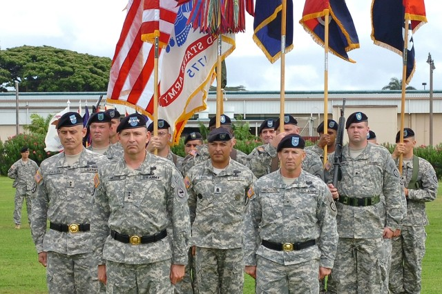 (From Left to Right) 25th ID Commander Maj. Gen. Robert L. Caslen Jr., USARPAC Commander Lt. Gen. Benjamin R. Mixon, 25th ID Command Sgt. Maj. Frank Leota, and outgoing 25th ID Commander Brig. Gen. Mick Bednarek stand before guidons of the various units from Schofield Barracks. Small formations of Soldiers from the 2nd Stryker Brigade Combat Team, 3rd Infantry Brigade Combat Team, 25th Special Troops Battalion and 25th Combat Aviation Brigade represented their units and division at the ceremony. ""