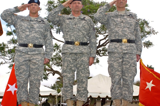 (From Left to Right) Outgoing 25th ID Commander Brig. Gen. Mick Bednarek, USARPAC Commander Lt. Gen. Benjamin R. Mixon and incoming Commander of the 25th ID Maj. Gen. Robert L. Caslen Jr. salute the colors at a ceremony held on Sills Field, May 21. The ceremony honored both incoming and outgoing leaders of Schofield Barracks in addition to recognizing the Division with the presenting it with two additional campaign streamers.