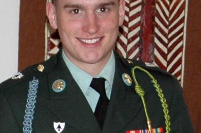 Spc. Ross A. McGinnis wears his service uniform with pride.