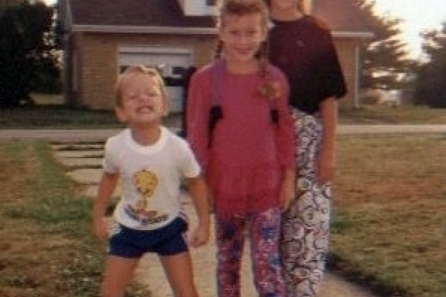 Ross at age 4 with his sisters Katie (center) and Becky.