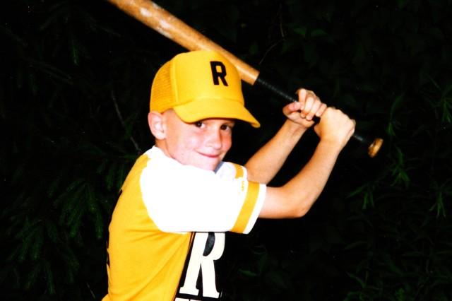 Ross, 6, playing Little League T-ball.