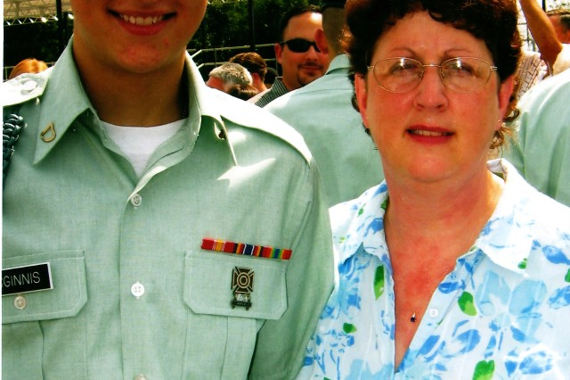 Spc. McGinnis, 18, with his mom at Advanced Individual Training Graduation, Fort Benning, Ga., 2005.