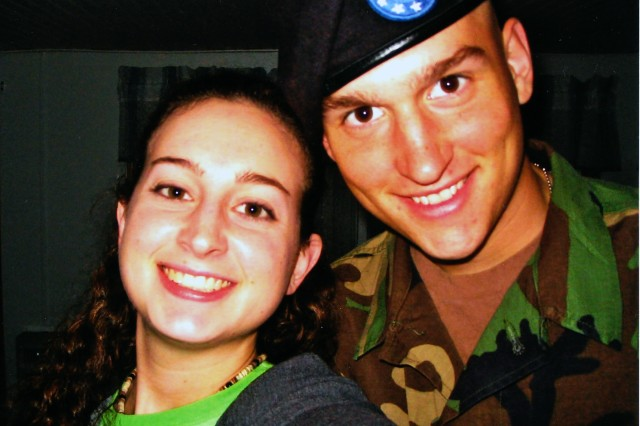Spc. McGinnis, 18, with sister Katie, 20.