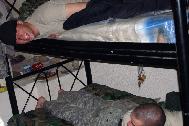 Spc. McGinnis relaxing on the top bunk at Forward Operating Base Apache, Iraq.