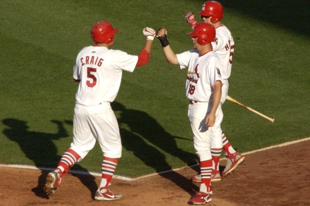 7.Cardinals third baseman Allen Craig, left, is congratulated by teammates Steven Hill (18) and Mark Hamilton after hitting a two-run home run in the first inning against the Tulsa Drillers, Saturday. Photo by Matt Decker