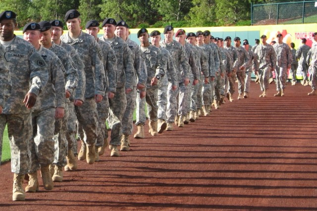 6.Soldiers parade onto the Hammons Field outfield during opening ceremonies. Photo by Tammy Decker