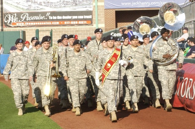 4.Fans applaud as the 399th Army Band marches toward home plate. Photo by Matt Decker