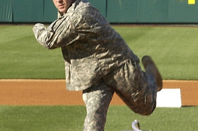 1.Brig. Gen. Thomas Spoehr, United States Army Chemical, Biological, Radiological, Nuclear School commandant, hurls a ceremonial first pitch to the plate, Saturday. Photo by Matt Decker