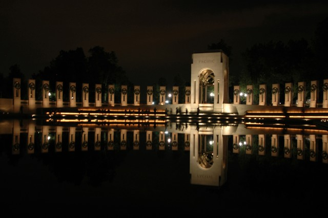 The National World War II Memorial, located on the National Mall, in Washington, D.C., is reflected in the central pool.