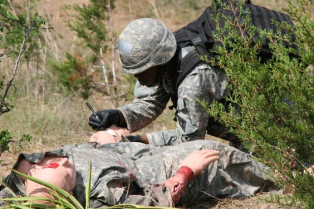 Sgt. 1st Class Jata Jordan provides first aid to a downed comrade. Rendering proper first aid to the wounded is crucial during the competition.
