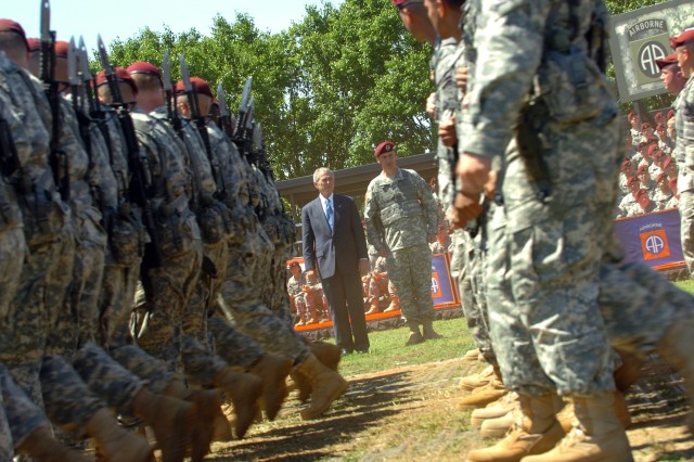President George W. Bush and 82nd Airborne Division Commanding General, Maj. Gen. David M. Rodriguez watch as 82nd paratroopers march by with fixed bayonets during the pass and review at Pike Field May 22.