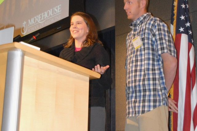 Retired Spc. B.J. Jackson and his wife Abby address the Wounded Troops and Partners: Supporting Intimate Relationships conference in Washington Wednesday about how they rebuilt their relationship after he lost both legs in Iraq. Jackson wears prosthetics with cartoons to make it easier for children to relate to him.
